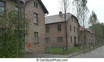 Auschwitz Buildings and Fence - Auschwitz concentration camp...
