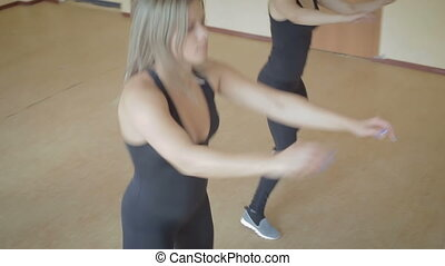 Beautiful young girl doing workout in dance studio stock footage video