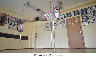 Beautiful young girls Pole dance studio stock footage video...