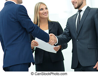 Business partner greeting each other with handshake -...