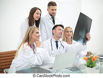 Portrait of confident happy group of doctors working at the...