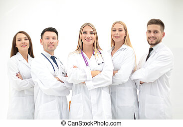 Team of medical professionals looking at camera, smiling. -...