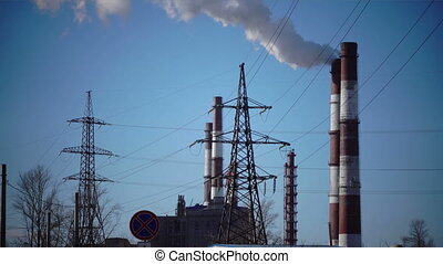 Industrial landscape. power line and smoke from pipes of...