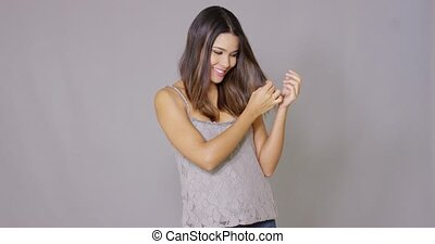 Beautiful young woman folds her arms and smiles at camera...