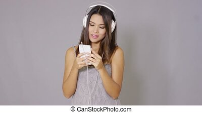 Woman singing along to her music - Happy vivacious young...