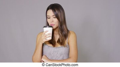 Smiling confident young woman drinking coffee - Smiling...