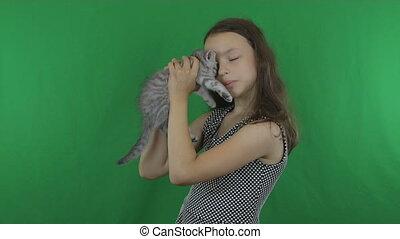 Beautiful girl communicates with kitten Scottish Fold on...