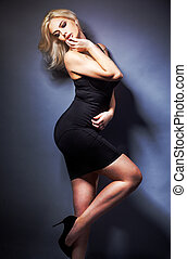 Beautiful woman on black classical dress pose