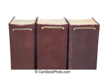 Three brown books isolated on white background.