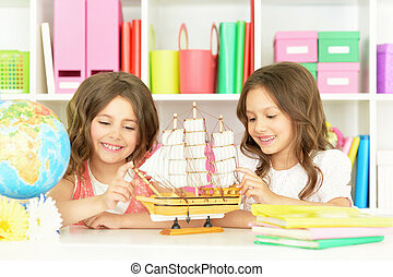 Cute girls  on lesson - Portrait of a cute girls on lesson