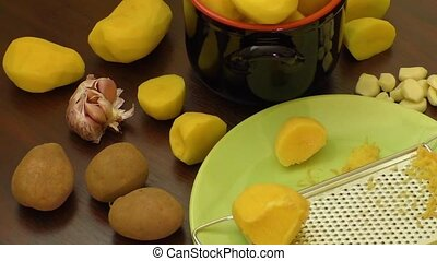 Peeled new potatoes in bowl on wooden table