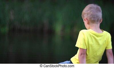 boy sitting on bridge at pool - cute boy sitting on bridge...