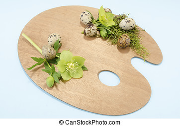 Easter palette decoration with boiled quail eggs and...