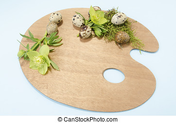 Easter palette decoration with sevenquail eggs and hellebore...