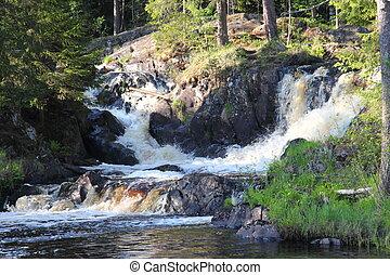 Waterfall in the Republic of Karelia, Russia. Northern...