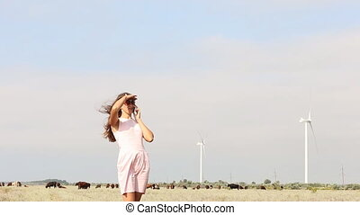 woman shows on wind power - happy woman shows on wind power