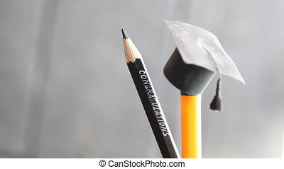 Graduation Cap and pencil with the inscription...