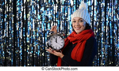 Winter woman with big alarm clock - Beautiful woman in warm...