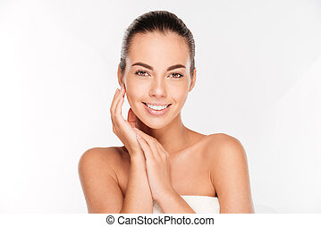 Beauty portrait of a young woman with skin care posing...