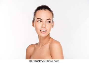 Beauty portrait of a beautiful woman with fresh skin looking...