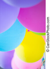 Colorful party balloon blur for background.