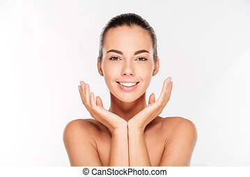 Beauty portrait of a young woman with fresh skin isolated on...