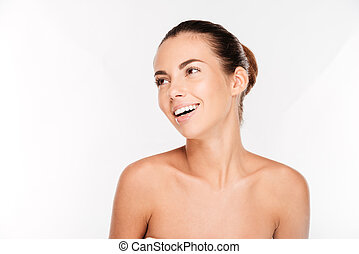 Beauty portrait of a pretty woman with fresh skin standing...