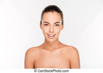 Portrait of a woman with fresh skin looking at camera -...