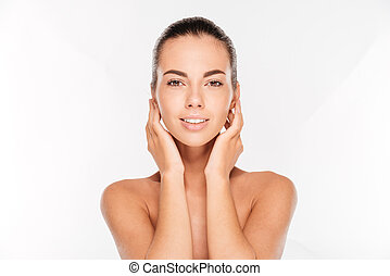 Beauty portrait of a young woman with skin care posing -...