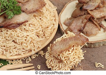 Instant noodles at blanched with baked pork delicious. -...