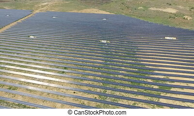 Aerial shot of solar panels - solar power plant. - Aerial...