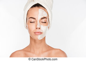 Young beautiful woman with facial mask