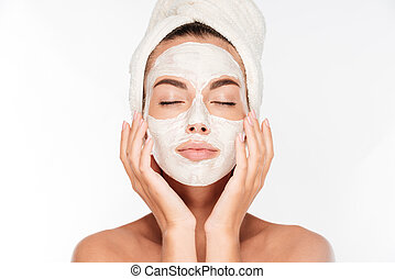 Woman with eyes closed and white facial mask on face -...