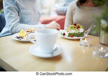 Delicious cakes at cafe - Elegant cafe table with slices of...