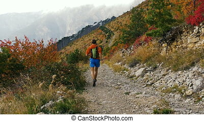 man runner running a mountain marathon