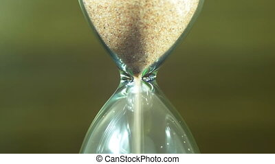 Hourglass on a Wooden Background, the Sand Falls Inside -...