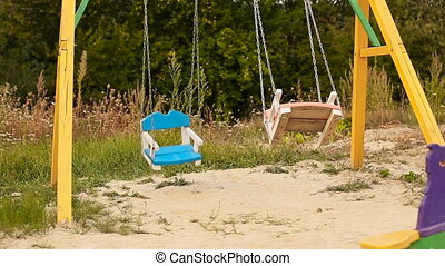 swing on the playground - swinging on a playground swing