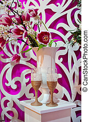 two glasses of champagne and vase of tulips