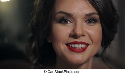 Portrait of amazing beautiful girl with red lips close-up. Happy woman smiling snow-white smile