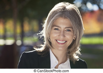 Portrait Of A Mature Businesswoman Smiling At The Camera....