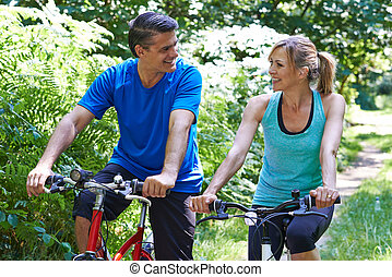 Mature Couple On Cycle Ride In Countryside