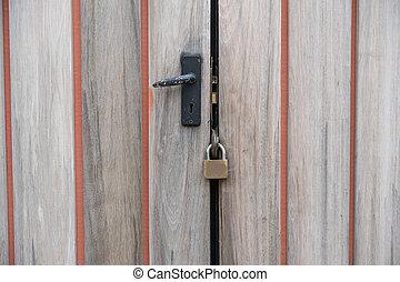 old wooden door with key lock.