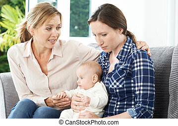 Mother Comforting Adult Daughter Suffering With Post Natal...