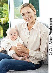 Portrait Of Grandmother With Baby Granddaughter