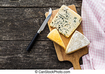 Different kinds of cheeses. - Different kinds of cheeses on...