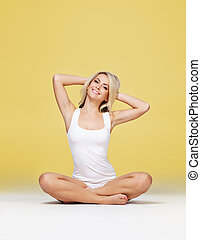 Young and fit woman in white sporty lingerie - Fit and...
