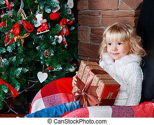 girl with Christmas tree - girl at home with Christmas tree...