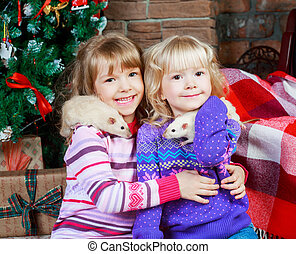 sisters with rats - two sisters at home with pet rats with...