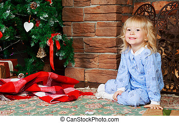 girl with Christmas tree - happy girl wearing pajamas at...