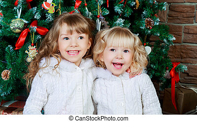 sisters with Christmas shop - two sisters at home with the...